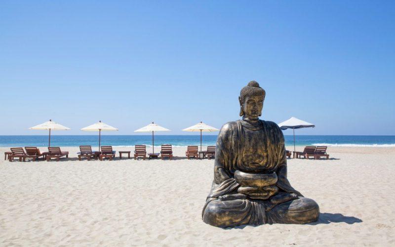 M60G9M Buddha Statue on Zicatela Beach, Puerto Escondido, Oaxaca, Mexico